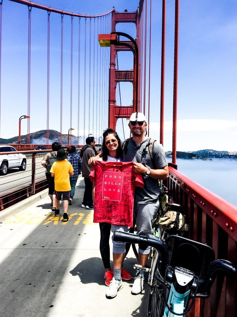 Garrett with his wife Ariel on the Golden Gate Bridge at the end of his journey.