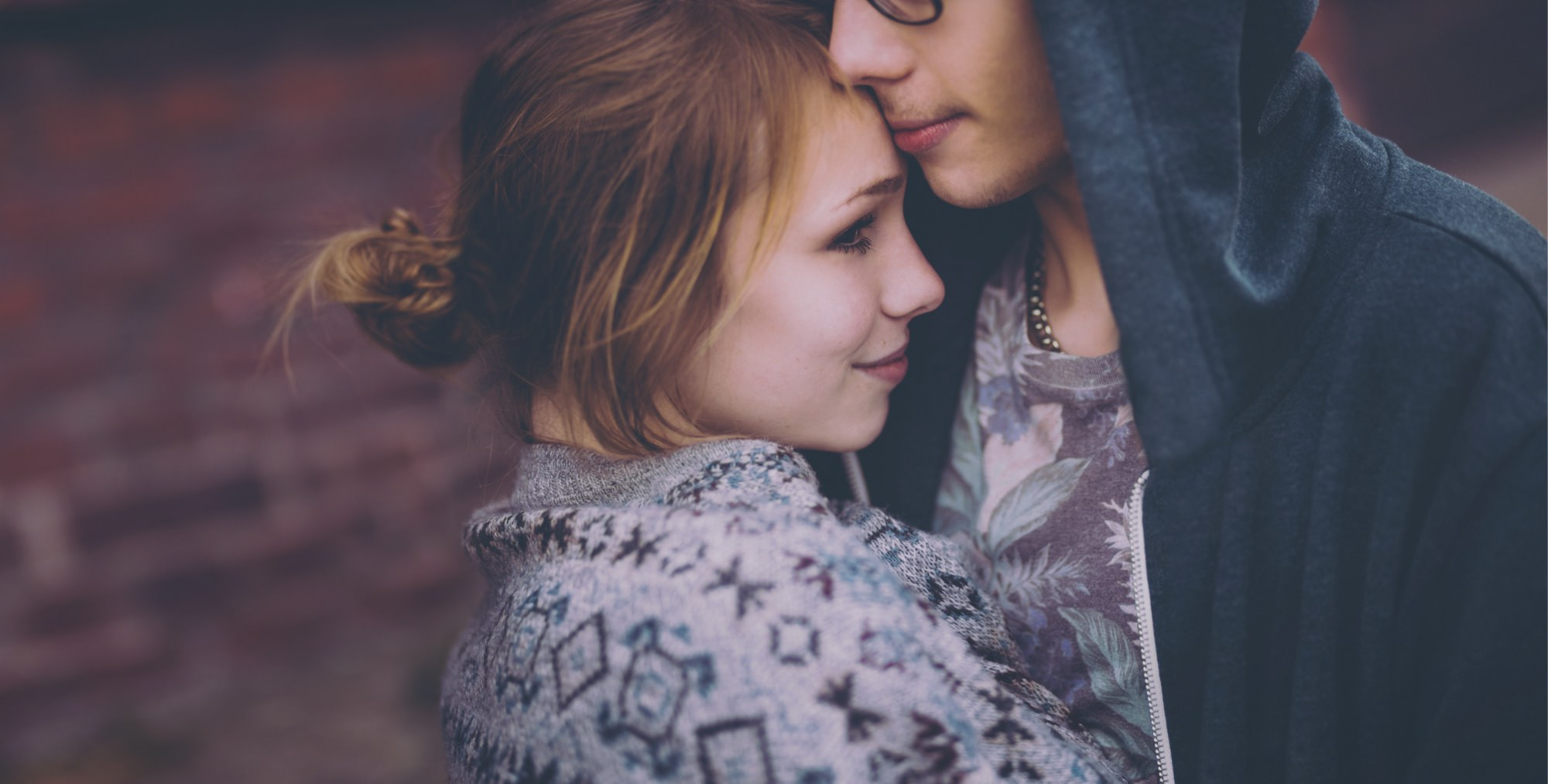 Close-up Of A Young Couple Hugging
