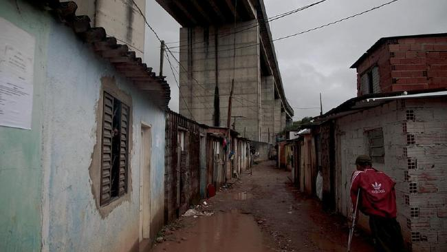 Child prostitutes as young as 11 work in this slum which lines the fence of the 2016 Olympic football stadium in Sao Paulo. Picture: Jota RoxoSource:Supplied