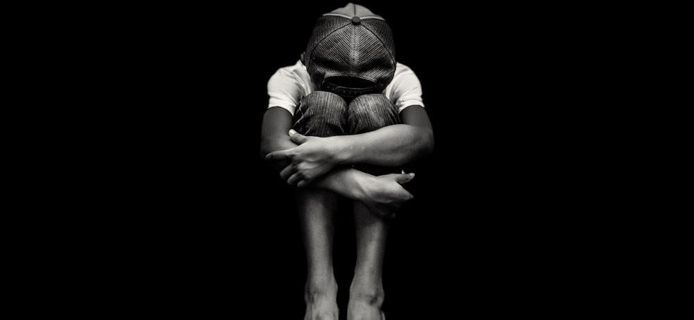 groom-child-porn-exploitation-black-and-white-boy-sad-alone