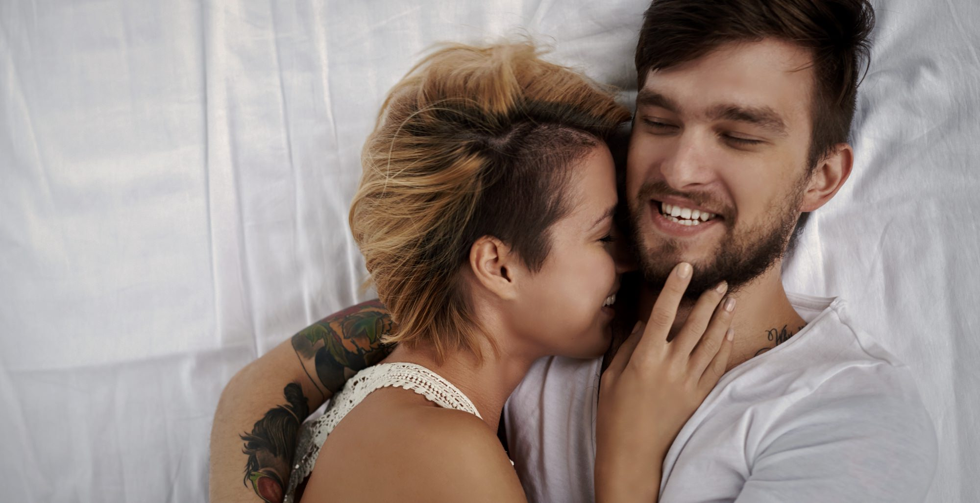 couple-tattoos-bed-happy-love