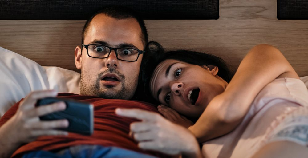 porn-gets-wrong-about-sex-education-couple-in-bed-shocked-surprised-sad-man-woman